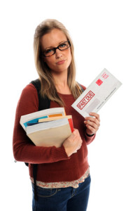 Student Holding Past Due Envelope